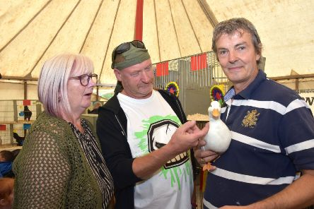 Stuart Kay with his champion white call duck and show visitors. Picture: John Edwards