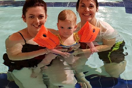 Maisey with her mum Rebecca and instructor Donna Smith.