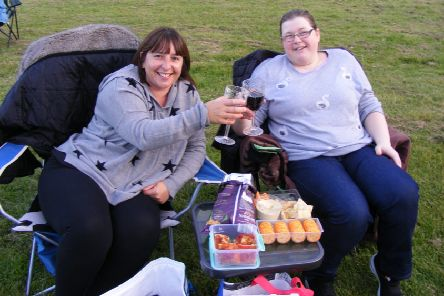 Victoria Backhouse and Linda Bailey raise a toast to their picnic in front of the movies. EMN-190909-194237001