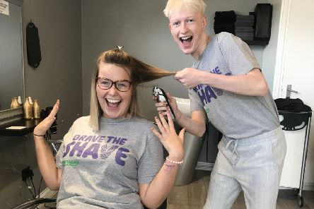 Preparing to Brave the Shave for Macmillan - Abbie Wells, 20, and Billy Wright, 17. EMN-190909-154546001