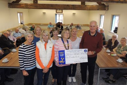 Sleaford Lionesses president Pam Kyte presents the donation of ?500 to Derek Arnold, chairman of Sleaford Parkinsons Support Group. EMN-190710-190108001