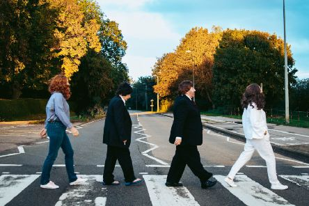 Take Note Choir members recreating The Beatles' Abbey Road album cover from 1969. EMN-191119-122631001