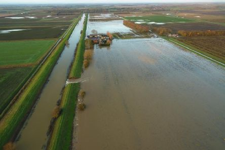 A stunning overhead view of the breach and flooded farmland at Martin Fen taken by staff at Beeswax Dyson Farming. EMN-190312-133703001