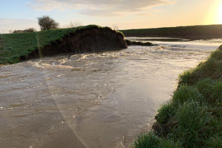 The breach in the bank of the Timberland Delph - now it has been blocked by sandbags and water is being pumped out to begin a permanent repair. Photo: Beeswax Dyson/Lincs Police