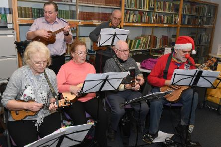 Festive Morning at Sleaford Library in aid of Cancer Research UK. Sleaford Ukulele group performing. EMN-191220-132811001