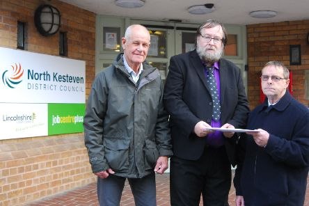Roy Barnes and Gerald Pask of Sleaford Indoor Bowls Club hand over their petition to NK Councillor David Suiter. EMN-191230-182657001