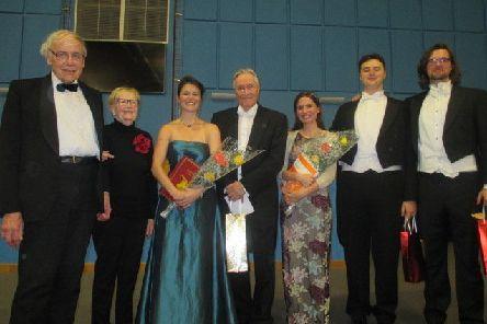 Musical director Alan Vincent, centre, after the presentation