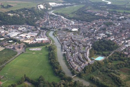 Aerial view of Lewes with a CGI impression of the new North Street Quarter development.