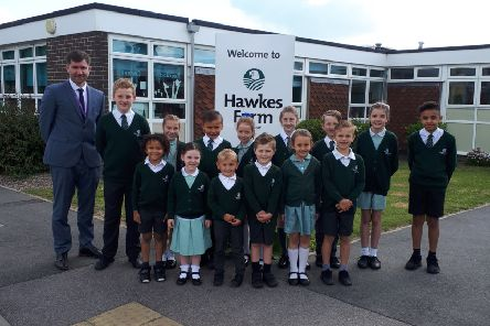 Head teacher Jeremy Meek with pupils Harry, Amelia, Alfie, Erin, Ellie, Dylan, Aimee, Cavalli, Carter, Sophie, Connor, Tommy, Beatrix and Coben