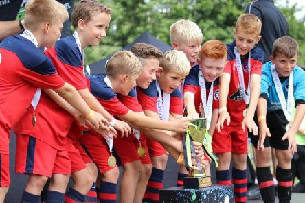 Eastbourne United under 10's lift a trophy. All pictures courtesy of Mark Newnham-Reeve.