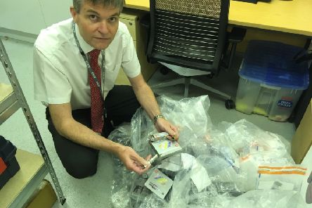 Richard Strawson from East Sussex Trading Standards with the car parts