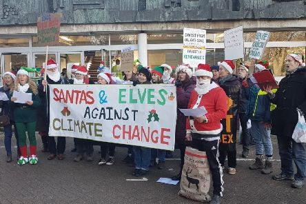 Santas and elves protesting outside County Hall in Lewes. Picture: Divest East Sussex
