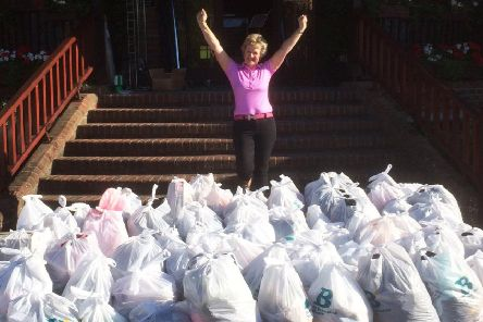 Megan pictured with donations she gathered for St Barnabas House