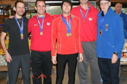 Some of the Lewes medalists from the Sussex Masters event, from left to right: Chris Gilbert, Adam Vaughan, Matt Bradford and Ben Hodgson. Sussex athletics president Ron Penfold (far right)