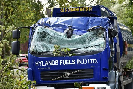 A falling tree hit an oil delivery lorry at Osborne Park in south Belfast during the heavy winds on Wednesday morning. Pic by Colm Lenaghan /Pacemaker
