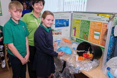 Eoin and Savannah view the ReCycling display