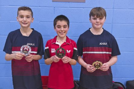 Under-13 gold winner Daniel Stone, centre.