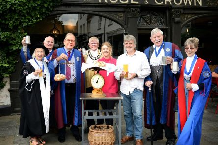 Gail Warrington, past Bread Weigher and current Low Bailiff of Warwick Court Leet, Alan Lettis, Organiser of Warwick Beer, cider and music festival and Juror of Warwick Court Leet, Roy Glassborow, current Bread Weigher, John Atkinson, Bailiff of Warwick Court Leet, Katie Middleton, Landlady of the Rose &Crown, Andy Sylvester, marketing writer and volunteer researcher, Graham Sutherland, Ale Taster of Warwick Court Leet and Mo Sutherland, past Bailiff of Warwick Court Leet. Photo by Gill Fletcher