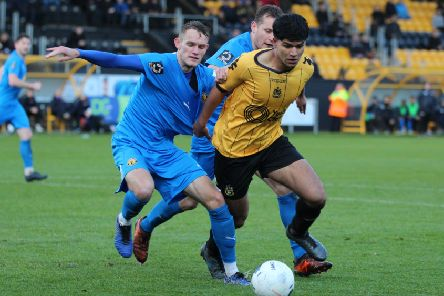 Callum Maycock battles for possession at Southport. Picture: Julia Urwin