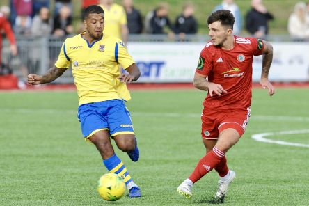 Kingstonian's Reece Hall, left, in action against Worthing.