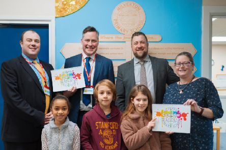 ehB Residential office manager Clive Thompson and MD Edward Bromwich join Milverton Primary School head Matt Fisher, Friends of Milverton Primary School member Fiona Henshaw and some pupils with the school's latest fundraising project.