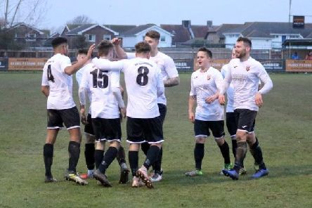 Pagham celebrate a recent goal against Loxwood - but they couldn't find the net at Gorings Mead / Picture by Roger Smith