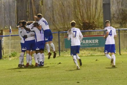 Haywards Heath Town players celebrate during their 2-0 win against Faversham. Picture by Grahame Lehkyj