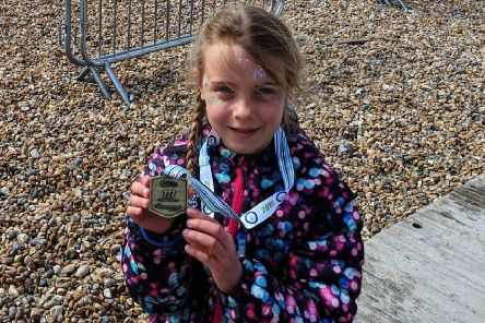 Daisy Akehurst, seven, completed the Cancer Research UK Mini Mile, her first race on her own