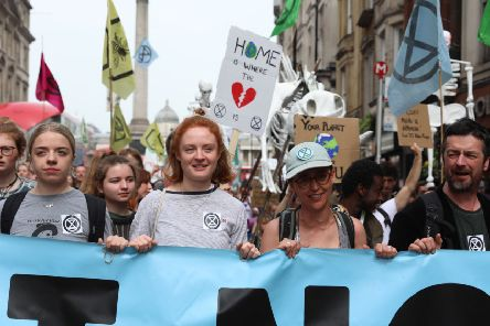 Climate change activists from the group Extinction Rebellion march down Whitehall as they protest in central London on April 24, 2019 (Photo by ISABEL INFANTES/AFP/Getty Images)