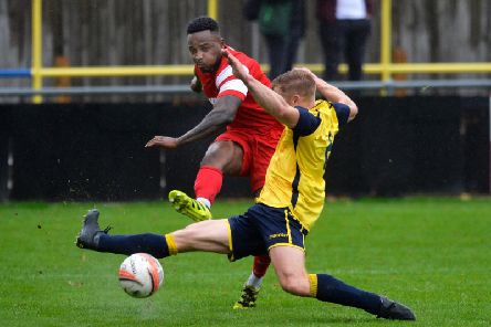 Tony Nwachukwu nets for Horsham YMCA at Eastbourne Town. Picture by Jon Rigby