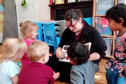 Reading with the children at Woodstock Day Nursery