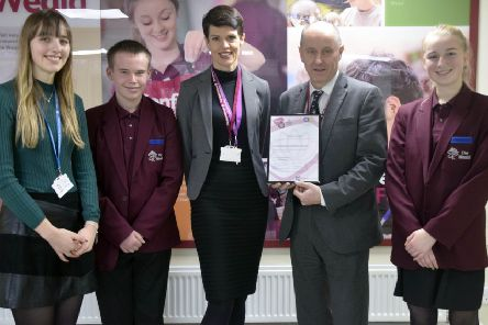 Headteacher Peter Woodman with deputy headteacher Sarah Edwards and student members of the wellbeing team SUS-200115-163135001
