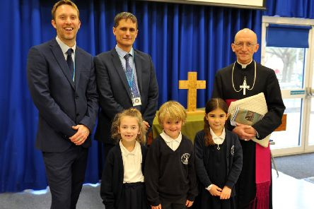 Bishop Martin with associate head teacher Andrew Lincoln, left, head teacher David Etherton and pupils at the 50th anniversary celebration for the laying of the foundation stone at St Nicolas and St Mary CE Primary School in Shoreham. Picture: Steve Robards SR20011602