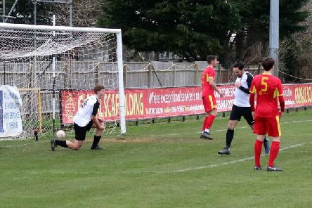 Pagham find the net against Newhaven / Picture: Roger Smith