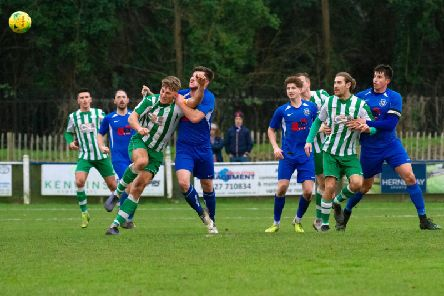 Eyes on the ball - action from Chichester's visit to Herne Bay / Picture: Neil Holmes