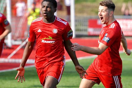 Kwame Poku celebrates scoring the opener in Worthing's 3-1 home win over AFC Hornchurch. All pictures by Stephen Goodger.