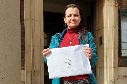 Andrea Gharsallah with the petition she received from Worthing Borough Council