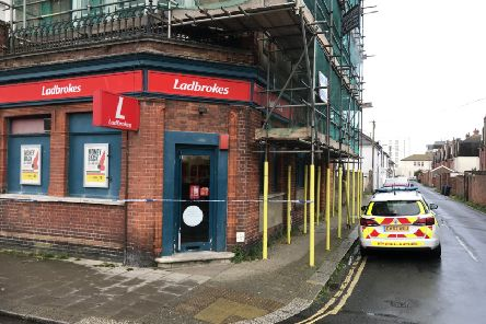 Police at the scene of the robbery in Worthing yesterday (April 24)