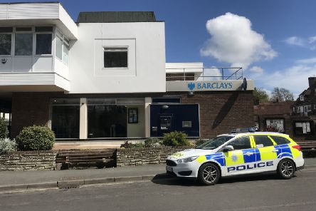 Police at the scene of the bank robbery in Storrington. Photo: Eddie Mitchell SUS-190425-143353001