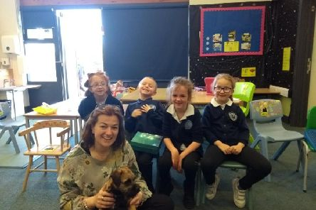 Headteacher Isabel Robson with Kirby, India Beverton, Jake Bowyer, Grace ONeill and Summer Canneaux