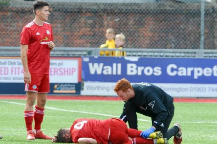 Darren Budd receives treatment in Worthing's defeat to Hornchurch. Picture by Stephen Goodger