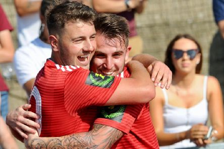 Reece Meekums (right) celebrates with two-goal hero Ollie Pearce in the derby win against Bognor. Picture by Stephen Goodger