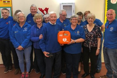 Adur East Lions with the defibrillator for Southwick Methodist Church