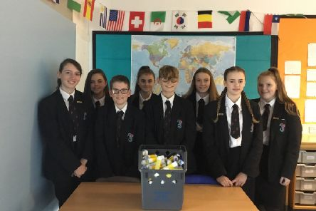 Durrington High students with gluesticks that have been collected for recycling