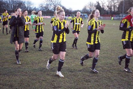 Crawley Wasps players thank the fans for their support as they leave the field.