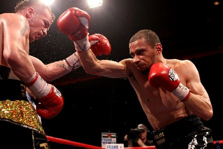 Curtis Woodhouse lands a punch against Frankie Gavin in 2011. (Photo by Scott Heavey/Getty Images)