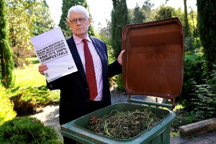 Horsham councillor Philip Circus with one of the bioplastic bags which a West Sussex waste management firm says cannot be added to garden waste . Photo: Steve Robatrds SR1908166 SUS-190325-170316001