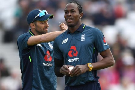 NOTTINGHAM, ENGLAND - MAY 17: Mark Wood of England pulls a label from Jofra Archer's shirt during the 4th One Day International between England and Pakistan at Trent Bridge on May 17, 2019 in Nottingham, England. (Photo by Gareth Copley/Getty Images) 775341612