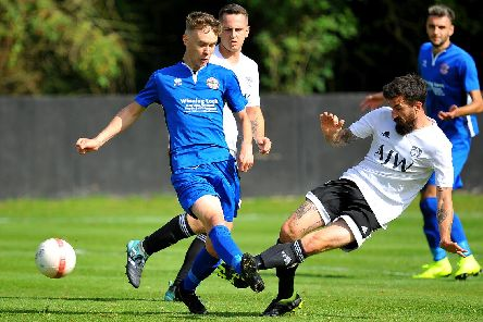 Loxwood's Spencer Slaugher puts in a challenge against Crawley Down Gatwick on Saturday. All pictures by Steve Robards
