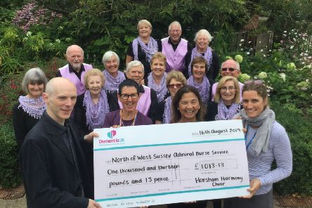 Horsham Harmony presenting the Admiral Nurses with the funds raised at its summer concert SUS-190820-153648001
